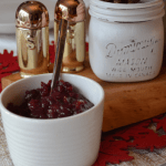 cranberry apple chutney in a jar with spoon