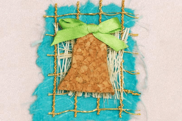 Christmas card with a 4 textures and a green ribbon