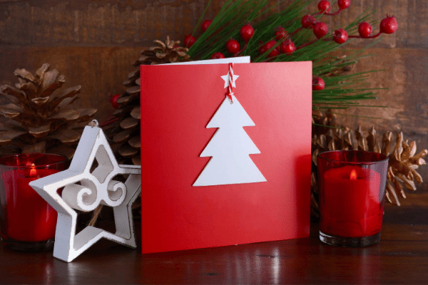 red card with white tree and ribbon