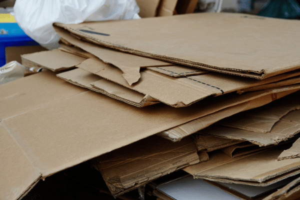 unlinked cardboard in a pile is the best bottom layer for the back to eden garden method