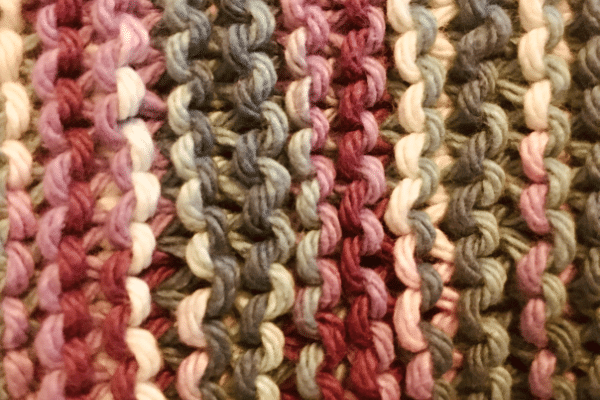 garter stitch close up photo in purple, blues and whites variegated cotton yarn